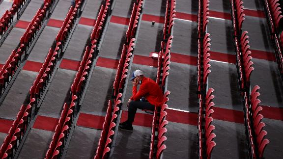 A man sits among rows of empty seats as he watches table tennis at the Tokyo Metropolitan Gymnasium on July 27.