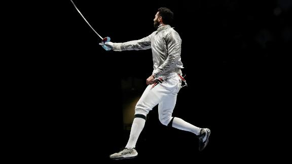Egyptian fencer Ziad Elsissy celebrates a team sabre win on July 28.