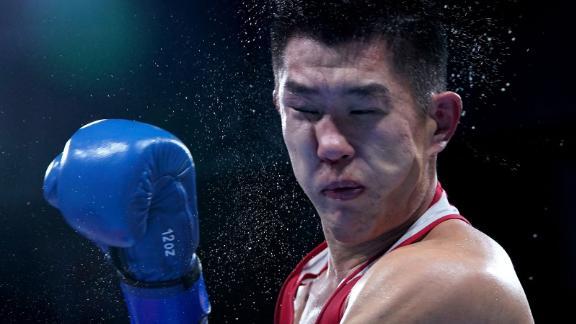 Kazakhstan's Bekzad Nurdauletov gets hit by Russian boxer Imam Khataev during their light-heavyweight match on July 28. Khataev won 4-1.