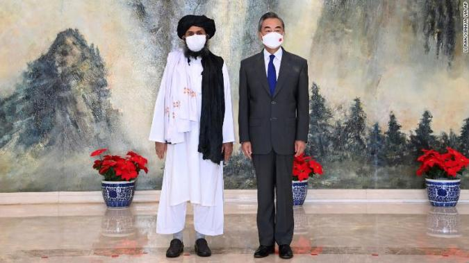 Taliban co-founder Mullah Abdul Ghani Baradar, left, and Chinese Foreign Minister Wang Yi pose for a photo during their meeting in Tianjin, China, on Wednesday, July 28.