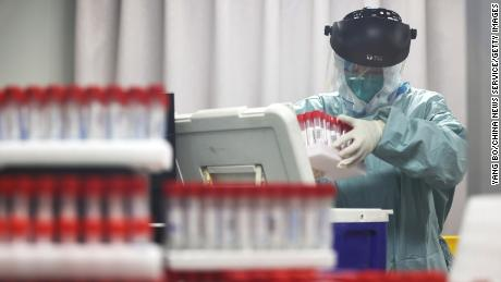 A medical worker works on samples from local residents to be tested for Covid-19 at a laboratory in Nanjing, China, on July 24.