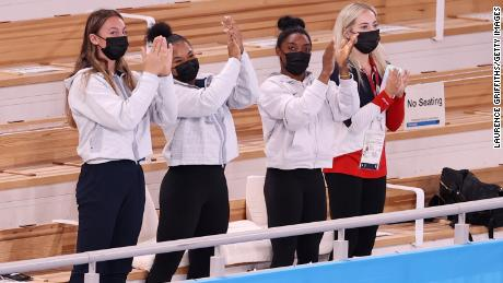 From left, American gymnasts Grace McCallum, Jordan Chillies, Simone Biles and Mykayla Skinner cheered on Lee following her gold medal performance.  Biles, the defending champion, withdrew from the event due to mental-health concerns.