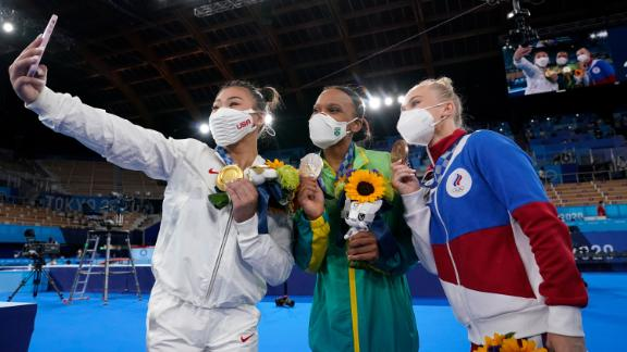 American gymnast Suni Lee takes a selfie with silver medalist Rebeca Andrade, center, and bronze medalist Angelina Melnikova after winning the individual all-around on July 29. Andrade is the first Brazilian to ever medal in women's gymnastics. Melnikova is Russian.