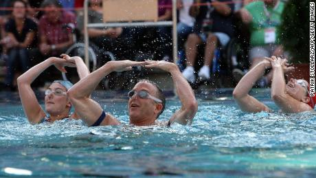 A team performs in the freestyle competition of the waterballet event of the 2010 Gay Games in Cologne, Germany.