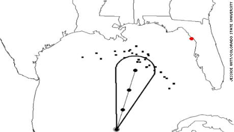 """In the experimental """"zoomies,"""" the black dots represent potential storm paths and move toward different locations. The cone represents the traditional NHC track forecast cone."""
