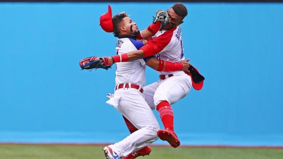 Dominican baseball players Gustavo Nunez, left, and Julio Rodriguez collide as Rodriguez catches a ball during their 1-0 win over Mexico on Friday, July 30.