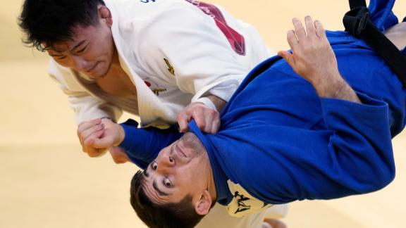 Shoichiro Mukai of Japan, top, and Germany's Eduard Trippel compete in their elimination round match in team judo on July 31.