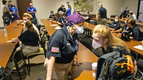 Hindy Bogner Orenstein, a nurse from Maryland chats with Bren Ingle, a nurse from Chattanooga, Tennessee, as nearly three dozen healthcare workers from around the country arrive to help supplement the staff at Our Lady of the Lake Regional Medical Center in Baton Rouge on August 2, 2021.