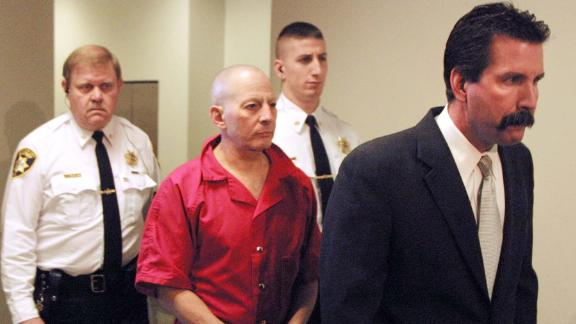 Durst, center, is escorted by Northampton County deputy sheriffs Dave Falco, rear left, and Keith Border, center rear, to a Northampton County courtroom before a hearing advising Durst of his rights under extradition laws in December 2001.