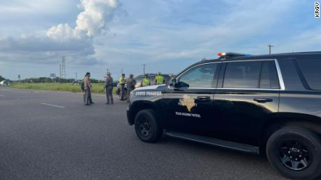 Emergency responders work at the scene of a deadly van crash in Encino, Texas, Wednesday.