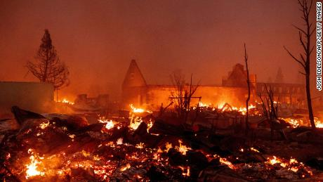 Buildings burn as the Dixie fire tears through downtown Greenville, California.