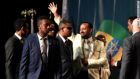 Prime Minister Abiy Ahmed waves to the Ethiopian diaspora assembled at an event in Washington, DC, in July 2018.