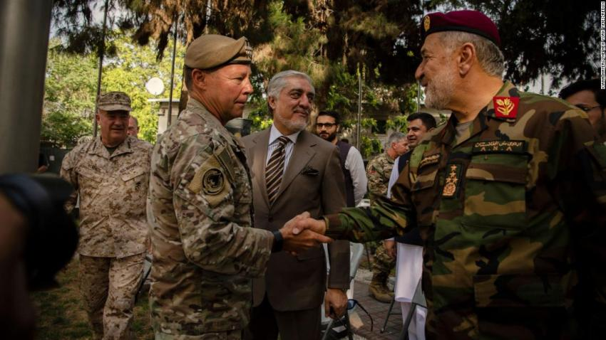 """US Gen. Austin S. Miller, left, greets Gen. Bismillah Khan Mohammadi, Afghanistan's defense minister, during a change-of-command ceremony in Kabul on July 12. Miller, the top American general in Afghanistan, was stepping down, a symbolic moment as the United States neared the end of its <a href=""""http://www.cnn.com/2021/04/14/middleeast/gallery/afghanistan-war/index.html"""" target=""""_blank"""">20-year-old war in the country.</a>"""