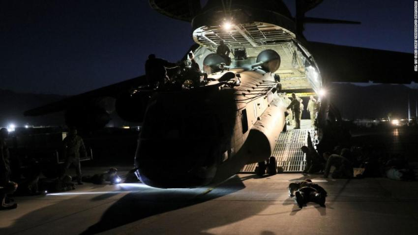 A helicopter is loaded onto a US Air Force plane as American forces carry out their withdrawal from Afghanistan on June 16.