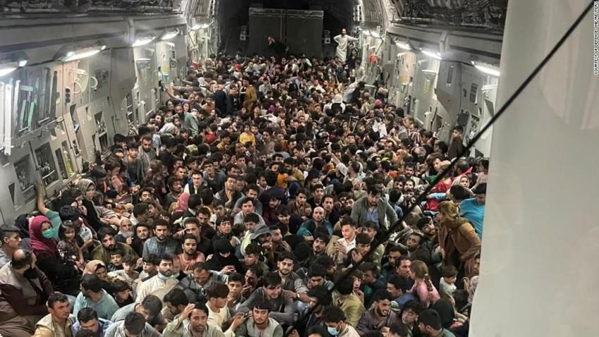 Evacuees crowd the interior of a US Air Force transport plane as they travel from Kabul to Qatar on August 15.