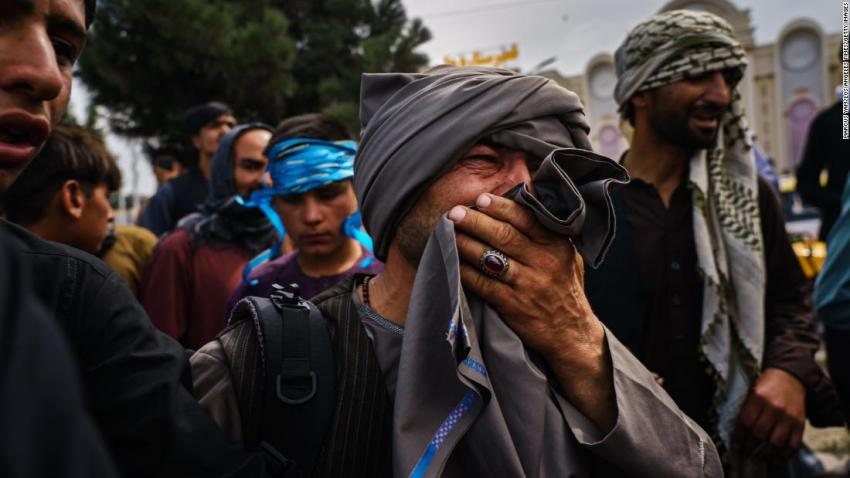 """A man reacts as he watches Taliban fighters use violence to control a crowd outside the airport on August 17. At least a dozen people were wounded in the incident, <a href=""""https://www.latimes.com/world-nation/story/2021-08-17/snapshot-of-suffering-afghans-trying-to-reach-airport-are-penned-up-beaten-by-taliban"""" target=""""_blank"""">according to the Los Angeles Times.</a>"""