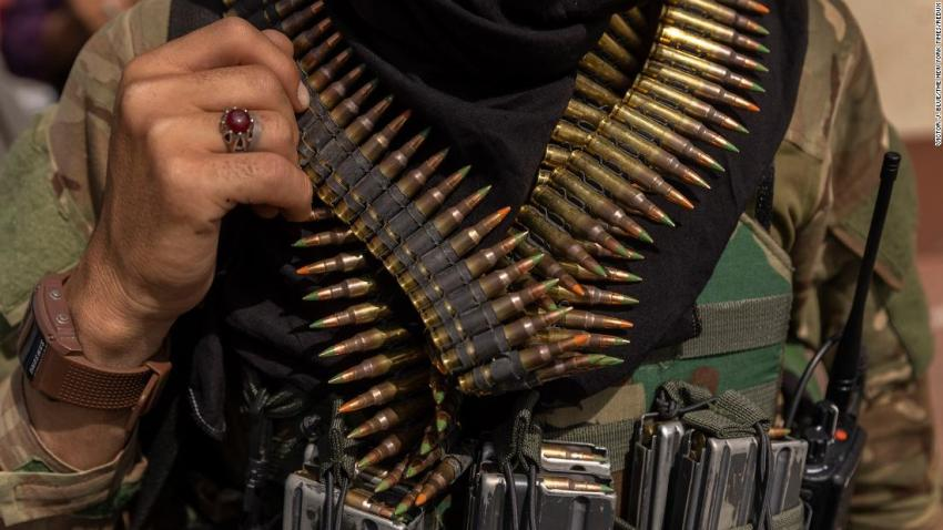 A heavily armed Taliban fighter guards the Afghanistan central bank in Kabul on August 19.