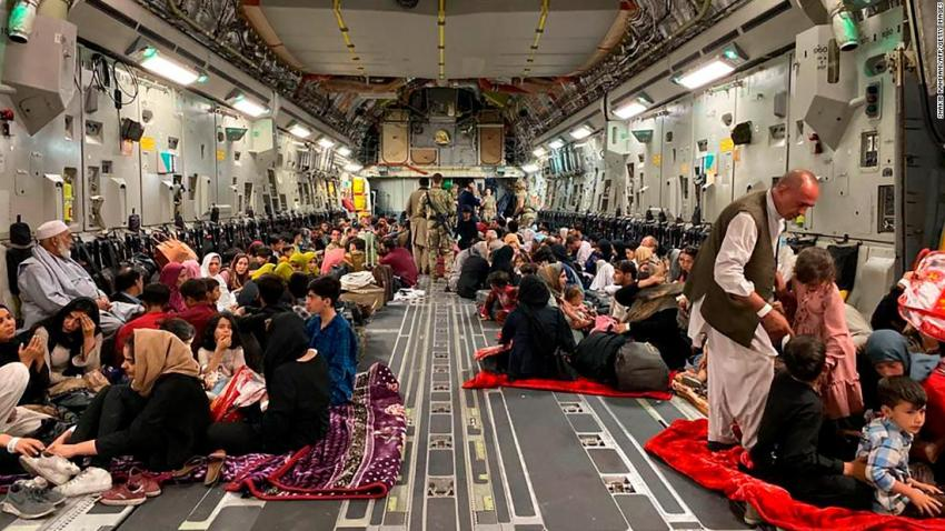 """Afghans sit inside a US military aircraft to leave Kabul on August 19. The US Air Force <a href=""""https://www.cnn.com/world/live-news/afghanistan-taliban-us-news-08-20-21/h_e066c6b39a904ab84d766a8f77176b1f"""" target=""""_blank"""">evacuated approximately 3,000 people from Kabul's international airport that day,</a> according to a White House official. Nearly 350 US citizens were among the evacuees, the official said, with the others being family members of US citizens, Special Immigrant Visa applicants and their families, and other vulnerable Afghans. Some civilian charter flights had also departed the Kabul airport in the previous 24 hours."""