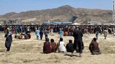 Hundreds of people gather near a US Air Force C-17 transport plane along the perimeter at the international airport in Kabul, Afghanistan on August 16.