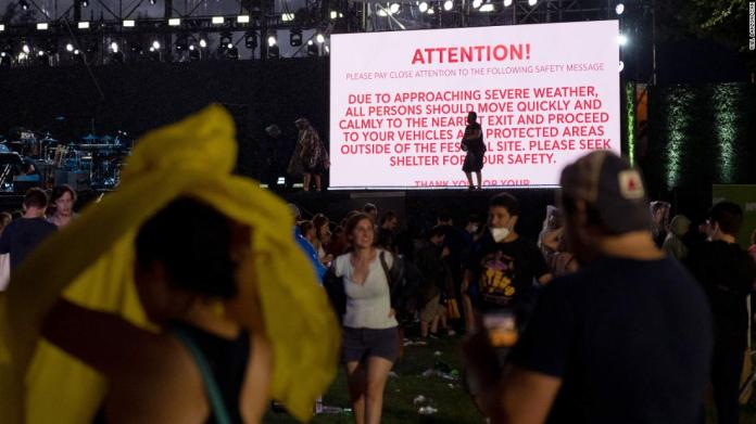 """A severe-weather warning is displayed as people leave<a href=""""https://www.cnn.com/2021/08/22/entertainment/gallery/we-love-nyc-concert/index.html"""" target=""""_blank""""> """"We Love NYC: The Homecoming Concert""""</a> on Saturday, August 21."""