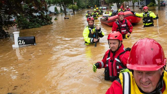 Members of the New Market Volunteer Fire Company search through flooded streets in Helmetta, New Jersey, on August 22.