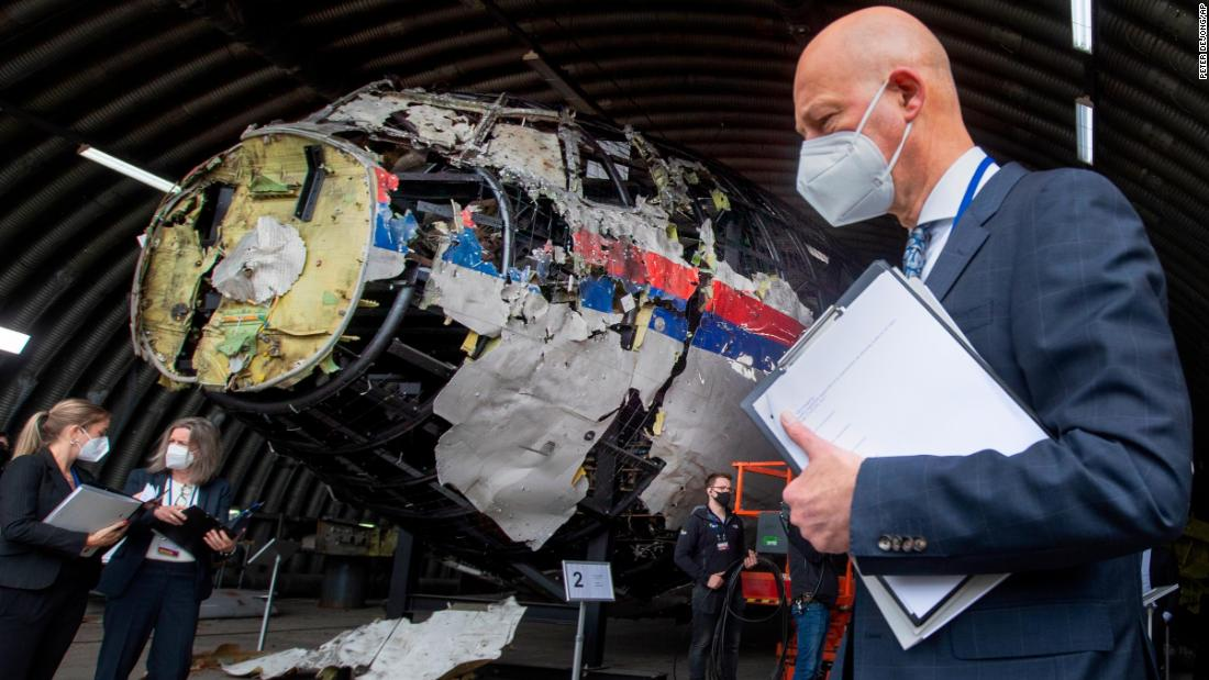 The reconstructed wreckage of Flight MH17 is seen behind presiding judge Hendrik Steenhuis, one of a team of judges and lawyers who assessed the evidence around the tragedy.