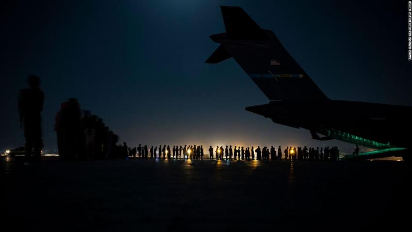 In this photo released by the US Air Force, an air crew prepares to load evacuees onto a C-17 transport plane at the airport in Kabul on August 21.