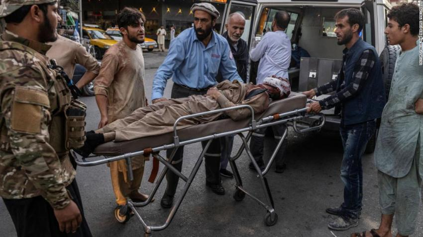 An injured person arrives at a hospital after the suicide bombing outside the airport in Kabul on August 26.