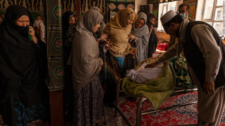 """Women weep at a mosque in Kabul on August 27 as they view the body of Hussein, a victim of the<a href=""""https://www.cnn.com/2021/08/26/asia/afghanistan-kabul-airport-blast-intl/index.html"""" target=""""_blank""""> suicide bombing </a>a day earlier."""