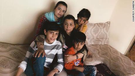 Four young children hiding in a Kabul apartment have reunited with their mother in the US