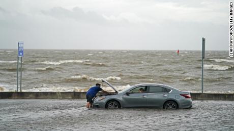 A stranded motorist on Beach Boulevard in Biloxi, Mississippi, on Monday.