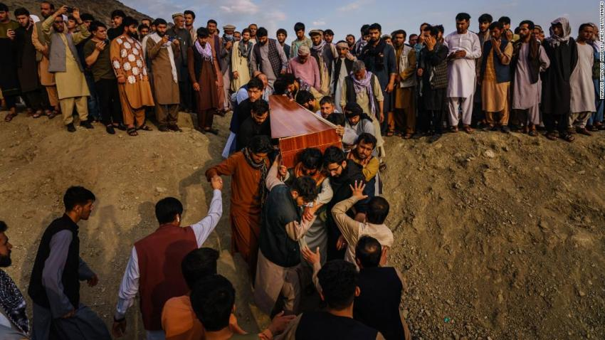 """A casket is brought to a grave site at a mass funeral in Kabul on August 30. <a href=""""https://www.cnn.com/2021/08/29/asia/afghanistan-kabul-evacuation-intl/index.html"""" target=""""_blank"""">Ten members of one family</a> — including seven children — were dead after a US drone strike targeted a vehicle in a residential neighborhood of Kabul, a relative of the dead told CNN. The United States carried out what it called a defensive airstrike in Kabul, targeting a suspected ISIS-K suicide bomber who posed an """"imminent"""" threat to the airport, US Central Command said. The Pentagon has said the strike resulted in secondary explosions and that those explosions may have been what killed the civilians."""