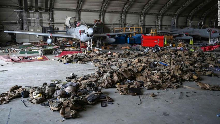 """Afghan Air Force attack aircraft are pictured amid armored vests inside a hangar at the Kabul airport on August 31. Pentagon Press Secretary John Kirby said the US military had made """"unusable all the gear that is at the airport -- all the aircraft, all the ground vehicles."""""""