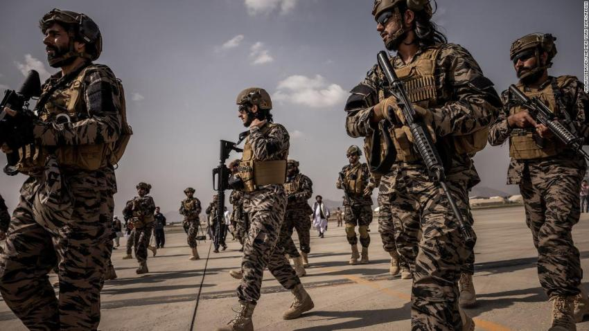 Heavily armed Taliban fighters are seen at the airport in Kabul on August 31.