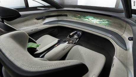 With the steering and pedals folded away, the front seat space in the Grandsphere becomes a lounge area.