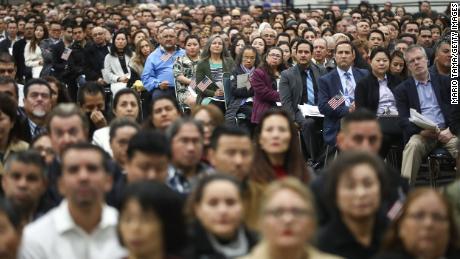 New US citizens gather at a naturalization ceremony on March 20, 2018, in Los Angeles. The  ceremony welcomed more than 7,200 immigrants from over 100 countries who took the citizenship oath and pledged allegiance to the American flag.