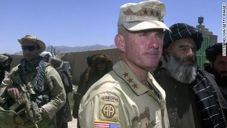 US Army General Dan McNeill, the commander of coalition forces in Afghanistan, speak to reporters in July 2002. McNeill had just met with local elders in the village of Deh Rawud in southern Afghanistan.
