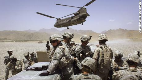 US soldiers deploy to a base in Afghanistan's Zabul province to fight Taliban militants in June 2006.