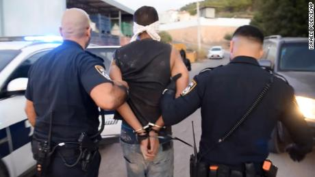 A photo provided by Israel Police shows Zakaria Zubeidi being arrested by Israeli police officers in Umm al Ghanam.