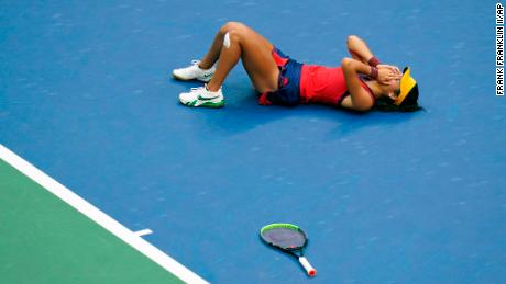 British player Emma Raducanu lies on the court after defeating Leylah Fernandez, of Canada, on September 11 in New York.