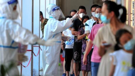 Residents queue to undergo nucleic acid tests for coronavirus in Xianyou county, Putian city, in China's eastern Fujian province on September 13.