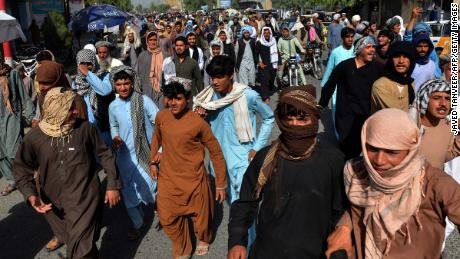 Local residents march against a reported announcement by the Taliban, asking them to evict their homes built on state-owned land in Kandahar on September 14.