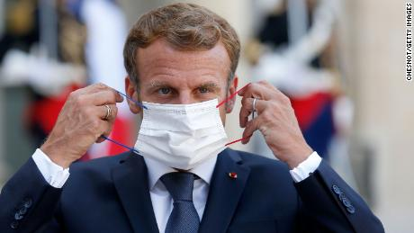 French President Emmanuel Macron adjusts his face mask at the Elysee Presidential Palace on September 6 in Paris, France.
