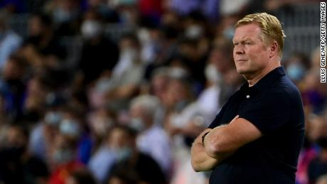 Dutch coach Koeman watches on during his side's 3-0 defeat.