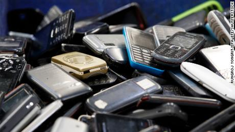 Mobile phones are dumped at Total Environmental Solutions' electronic waste recycling plant in Thailand in 2020.