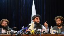 Taliban spokesman Zabihullah Mujahid (C) gestures as he addresses the first news conference in Kabul on August 17, following the Taliban's takeover of Afghanistan.