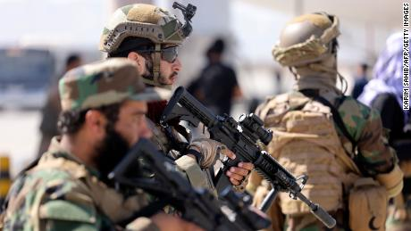 Fighters of the Taliban Badri 313 military unit stand guard at the airport in Kabul on September 14.