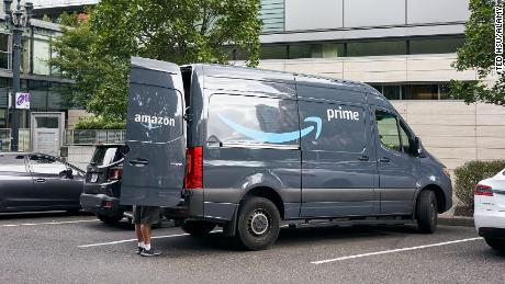 An Amazon worker is seen unloading an Amazon Prime branded van on the roadside in downtown Portland, Oregon in September 2019.