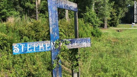 A wooden memorial erected for Stephen Nicholas Smith, 19, who was found dead on a country road in 2015.