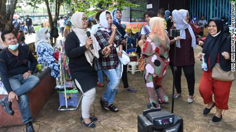 A group of residents gather for an outdoor karaoke session at a park on the outskirts of Jakarta, Indonesia, on September 19.